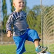 Cute little boy and his soccer ball — Stock Photo