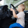 Little boy pretending to drive — Stock Photo
