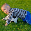 Royalty-Free Stock Photo: Boy diving on a soccer ball