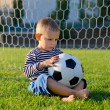 Little boy in the goal with his soccer ball — Stock Photo
