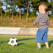 Little boy learning to play soccer — Stock Photo