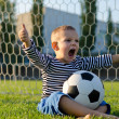 Boy with football shouting with glee — Lizenzfreies Foto