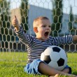 Boy with football shouting with glee — Stock Photo