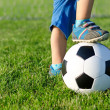 Boy with his foot on a soccer ball — Stock Photo
