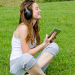 Young girl enjoying her music — Stock Photo