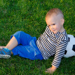 Youngster lying against his soccer ball — Stock Photo