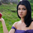 Disconsolate woman with an apple — Stock Photo #14036316