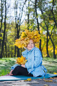 Little girl with colourful autumn headdress — Stock Photo
