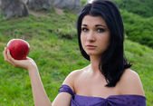 Disconsolate woman with an apple — Stock Photo