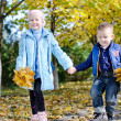 Young children skipping hand in hand — Stock Photo