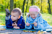 Two Young Children Relaxing in a Park — Stock Photo