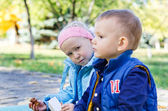 A boy and a girl in the park — Stok fotoğraf