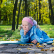 Mischievous small girl in park — Stock Photo #14151193