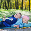 Little boy lying on his sister — Stock Photo