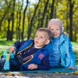 Cute little brother and sister playing outdoors — Stock Photo