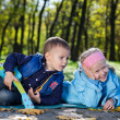 Brother and sister playing in a park — Stock Photo