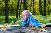 Mischievous small girl in a park — Stock Photo