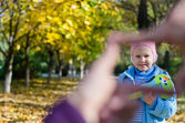 Little girls smiling face in a finger frame — Stock Photo