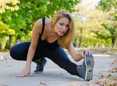 Blonde athlete warming up — Stock Photo