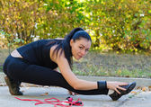 Woman warming up before training — Stock Photo