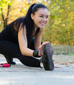 Happy woman exercising in a park — Stock Photo