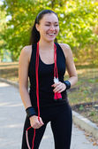 Laughing woman with a skipping rope — Stock Photo
