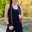 Stock Photo: Beautiful womwith resistance band