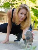 Athletic supple wman exercising — Stock Photo
