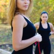 Beautiful Women exercising outdoors - Stock Photo