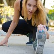 Attractive blonde girl working out - Stock Photo