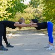 Pair of women working out together - Stockfoto