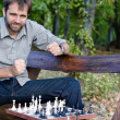 Stock Photo: Middle aged mplaying chess with himself
