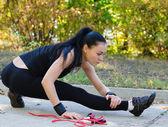 Stretching girl in black leotard — Stock Photo