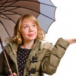 Smiling woman holding out her hand for rain — Stock Photo