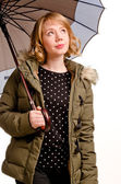 Hopeful woman checking out the weather — Stock Photo