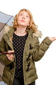 Dubious blonde woman watching the weather — Stock Photo