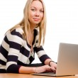 Trendy young woman with a laptop — Stock Photo #16232791