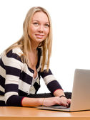 Smiling woman working on a laptop — Stock Photo
