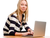 Trendy young woman with a laptop — Stock Photo
