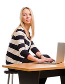 Attractive student using a laptop — Stock Photo