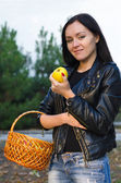 Attractive woman holding an apple — Stock Photo