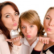Mischievous ladies blowing kisses — Stock Photo