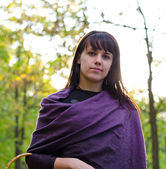 Young woman wearing a purple shawl — Stock Photo