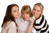 Three smiling young women — Stock Photo