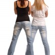 Rear view of two girls in tight fitting jeans — Stock Photo #17431759