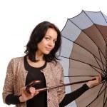 Beautiful brunette woman holding an umbrella — Stock Photo #18546667