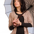 Stock Photo: Resigned womwatching rain