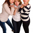 Three sexy girls blowing a kiss - Stock Photo