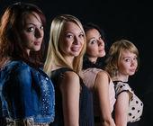 Four stylish beautiful women — Stock Photo