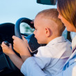 Stock Photo: Small boy learning to drive